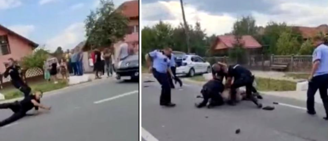 VIDEO: Polițiști amenințați cu bătaia. Mașina lor, lovită cu parul