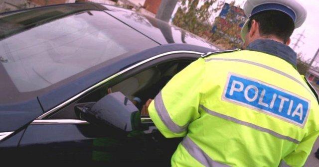 Iubita a trecut pe locul șoferului după ce mașina a fost oprită de Poliție